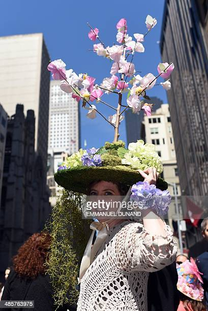 Participants display their outfits during the annual Easter Parade on Fifth Avenue in New York on April 20 2014 The annual parade has been a New York...