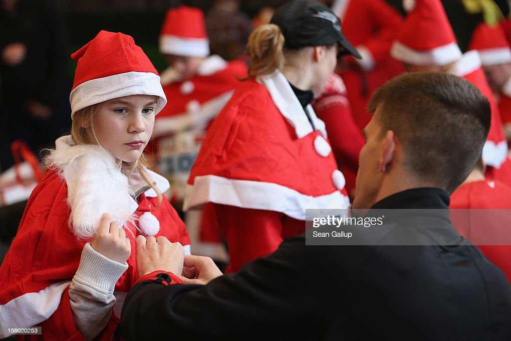 Participants dress as Santa Claus in a local community hall shortly before the 4th annual Michendorf Santa Run (Michendorfer Nikolauslauf) on December 9, 2012 in Michendorf, Germany. Over 800 people took part in this year's races that included children's and adults' races.