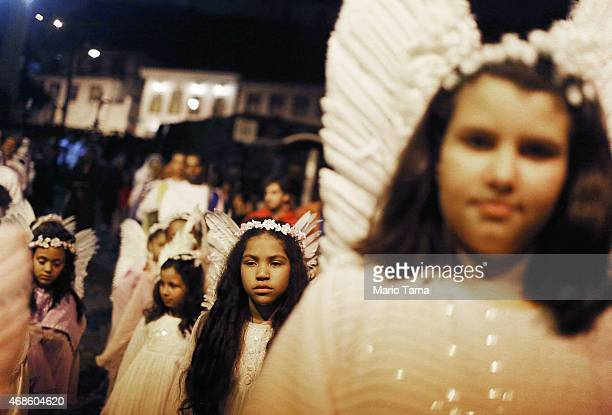 Participants dressed as angels stand while marching in a traditional Semana Santa procession on Good Friday on April 3 2015 in Ouro Preto Brazil Holy...