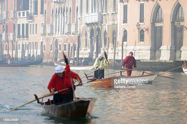 Participants dressed as 'Befana' row on Gran Canal during the traditional Epiphany Boat Race on January 6 2013 in Venice Italy In Italy Epiphany is...
