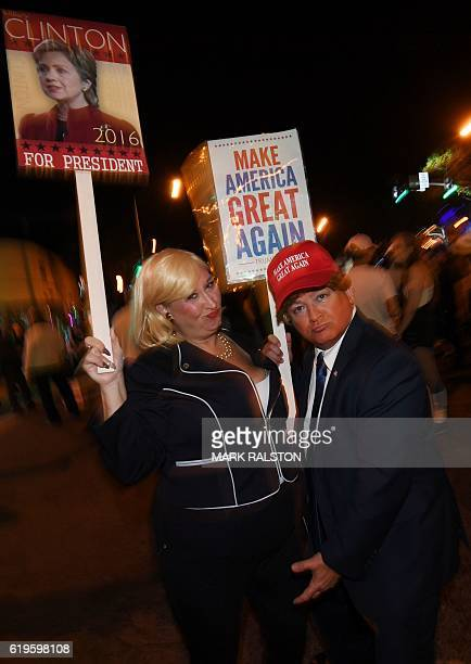 Participants dressed as Democratic presidental nominee Hillary Clinton and Republican presidential nominee Donald Trump parade along Santa Monica...