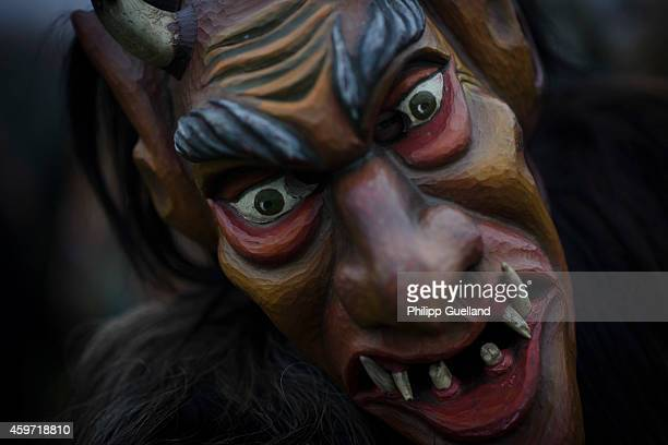 Participants dressed as Perchten roam village streets to chase away evil winter spirits in the annual Perchten gathering in Bavaria on November 29...