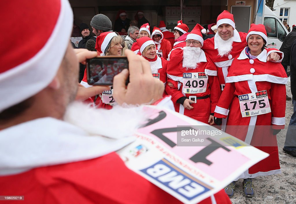 Participants dressed as Santa Claus photograph one another as they gather shortly before the 4th annual Michendorf Santa Run (Michendorfer Nikolauslauf) on December 9, 2012 in Michendorf, Germany. Over 800 people took part in this year's races that included children's and adults' races.