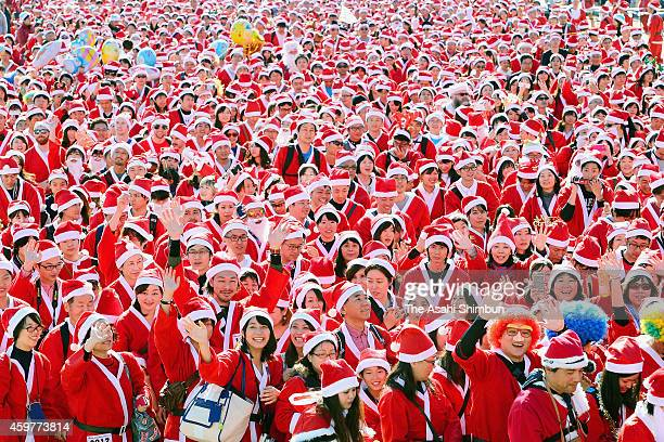 Participants dressed as Santa Claus run the annual Osaka Great Santa Run at the Osaka Castle Park on December 1 2014 in Osaka Japan Participation...