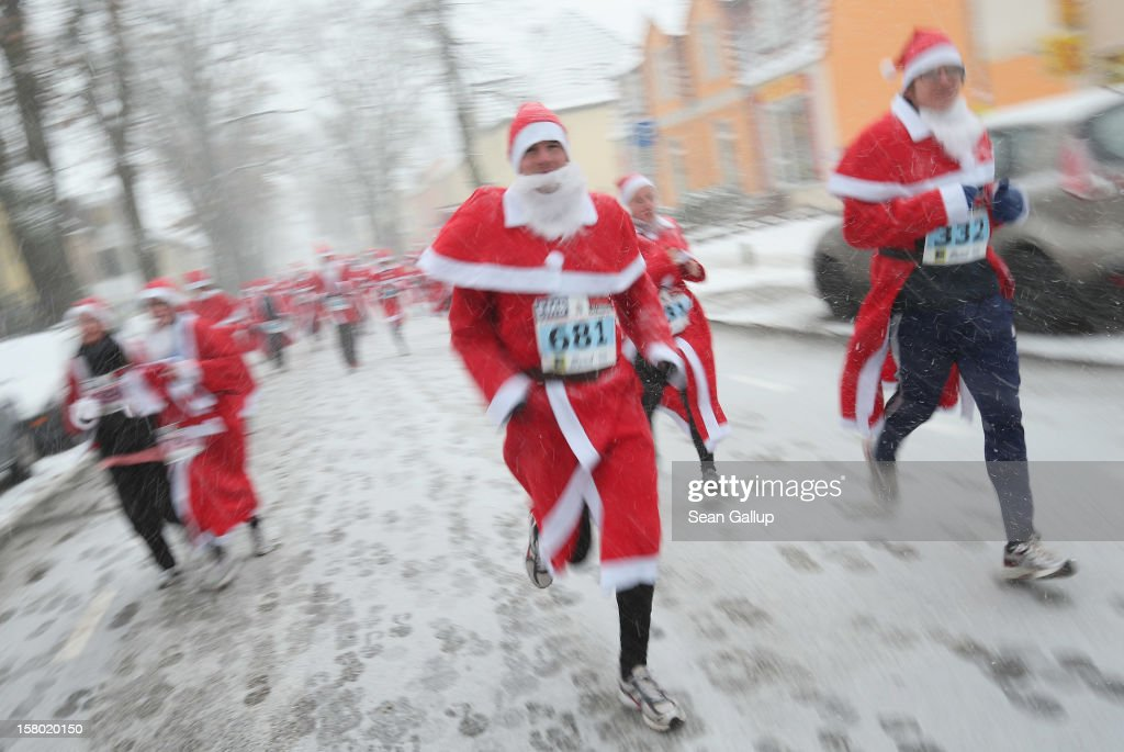 Participants dressed as Santa Claus run through falling snow in the 4th annual Michendorf Santa Run (Michendorfer Nikolauslauf) on December 9, 2012 in Michendorf, Germany. Over 800 people took part in this year's races that included children's and adults' races.