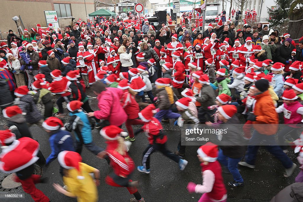 Participants dressed as Santa Claus watch children take off in the children's race during the 4th annual Michendorf Santa Run (Michendorfer Nikolauslauf) on December 9, 2012 in Michendorf, Germany. Over 800 people took part in this year's races that included children's and adults' races.