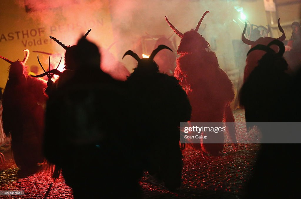 Participants dressed as the Krampus creature walk the streets in search of delinquent children during Krampus night on November 30, 2013 in Neustift im Stubaital, Austria. Sixteen Krampus groups including over 200 Krampuses participated in the first annual Neustift event. Krampus, in Tyrol also called Tuifl, is a demon-like creature represented by a fearsome, hand-carved wooden mask with animal horns, a suit made from sheep or goat skin and large cow bells attached to the waist that the wearer rings by running or shaking his hips up and down. Krampus has been a part of Central European, alpine folklore going back at least a millennium, and since the 17th-century Krampus traditionally accompanies St. Nicholas and angels on the evening of December 5 to visit households to reward children that have been good while reprimanding those who have not. However, in the last few decades Tyrol in particular has seen the founding of numerous village Krampus associations with up to 100 members each and who parade without St. Nicholas at Krampus events throughout November and early December.