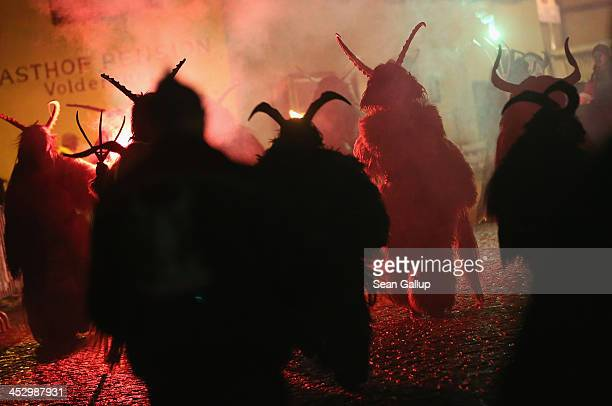 Participants dressed as the Krampus creature walk the streets in search of delinquent children during Krampus night on November 30 2013 in Neustift...