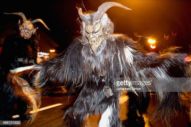 Participants dressed as the Krampus creature walk the streets in search of delinquent children during a Krampus run on November 28 2015 in Salzburg...