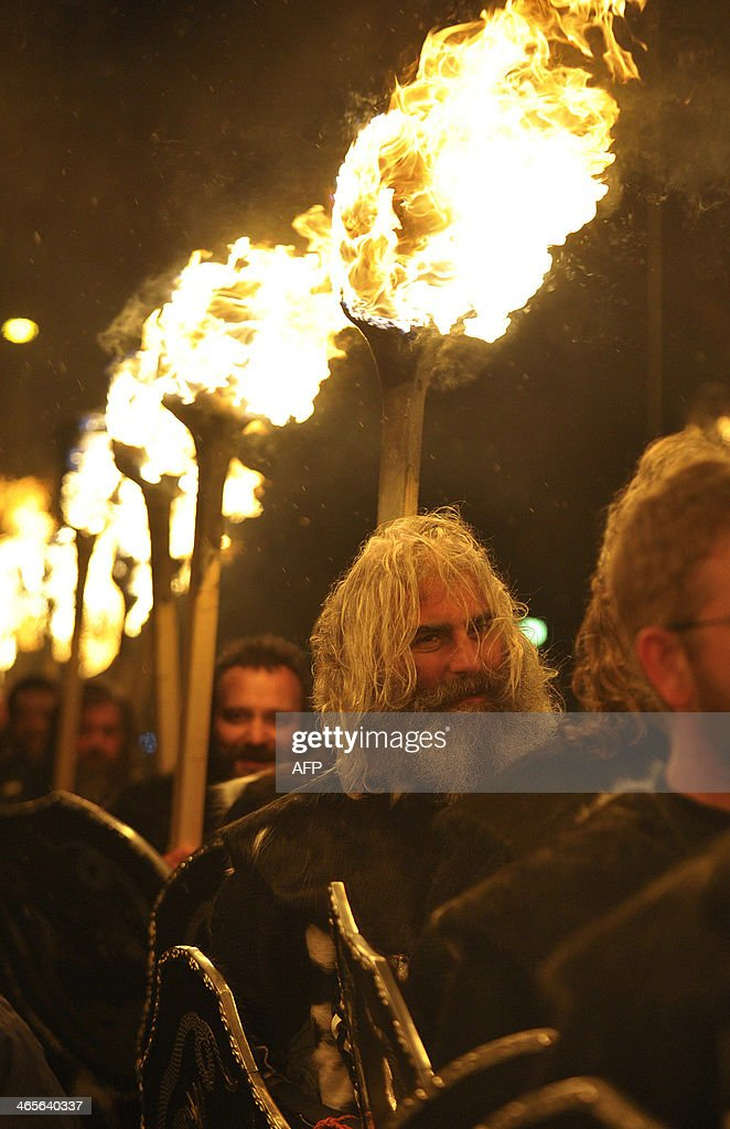 Participants dressed as Vikings carry burning brands as they take part in the annual Up Helly Aa festival in Lerwick Shetland Islands on January 28...