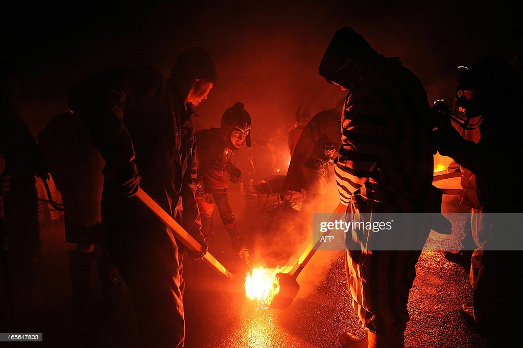 Participants dressed as Vikings light their burning brands as they take part in the annual Up Helly Aa festival in Lerwick Shetland Islands on...