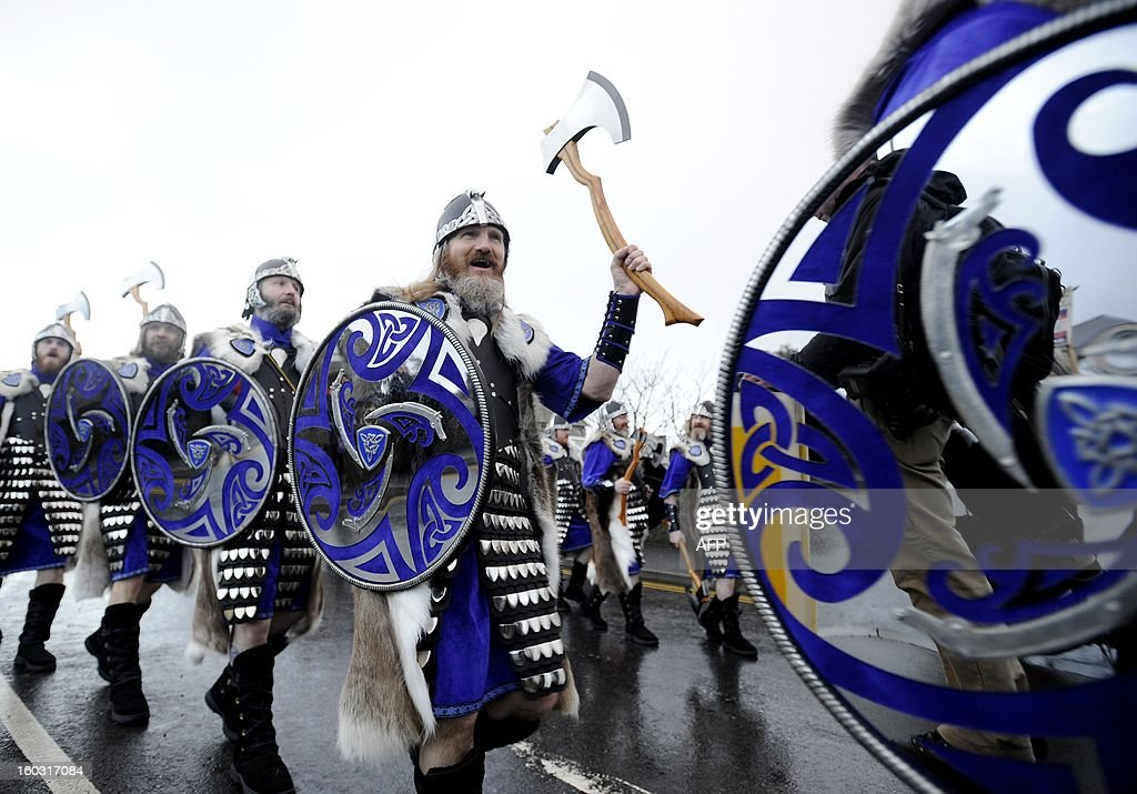 Participants dressed as Vikings march past during the annual Up Helly Aa festival in Lerwick, Shetland Islands on January 29, 2013. Up Helly Aa celebrates the influence of the Scandinavian Vikings in the Shetland Islands and culminates with up to 1,000 'guizers' (men in costume) throwing flaming torches into their Viking longboat and setting it alight later in the evening.