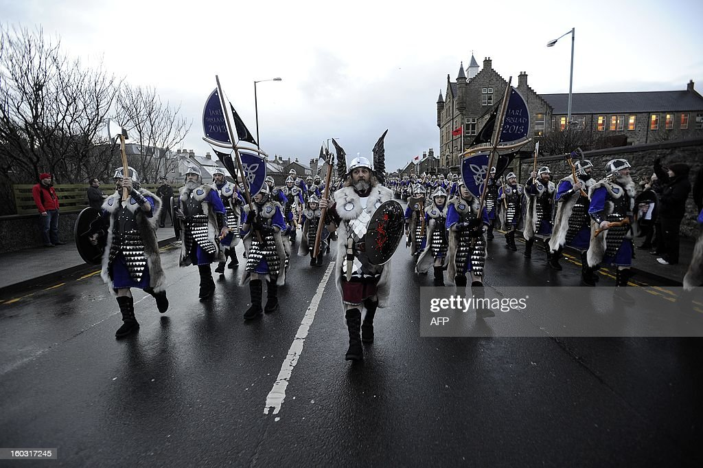 Participants dressed as Vikings march past during the annual Up Helly Aa festival in Lerwick Shetland Islands on January 29 2013 Up Helly Aa...