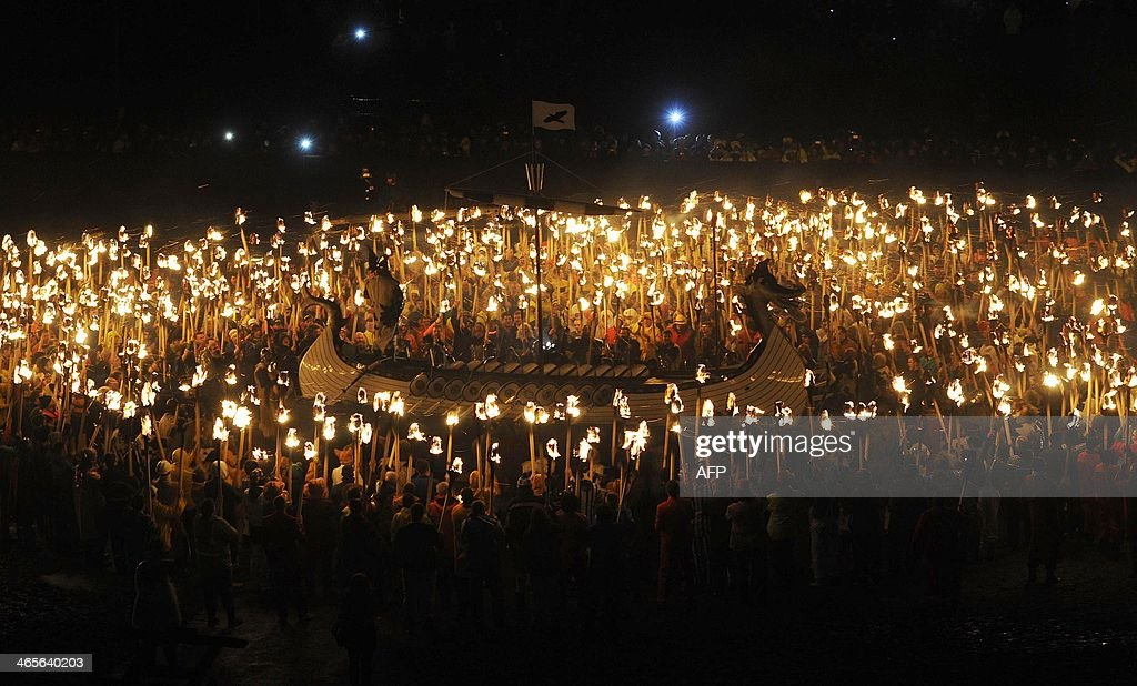 Participants dressed as Vikings participate in the annual Up Helly Aa festival in Lerwick Shetland Islands on January 28 2014 Up Helly Aa celebrates...