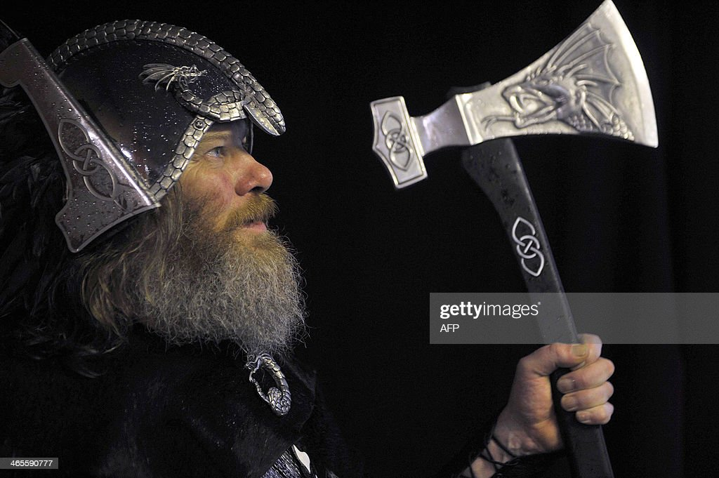 Participants dressed as Vikings prepare to participate in the annual Up Helly Aa festival in Lerwick Shetland Islands on January 28 2014 Up Helly Aa...