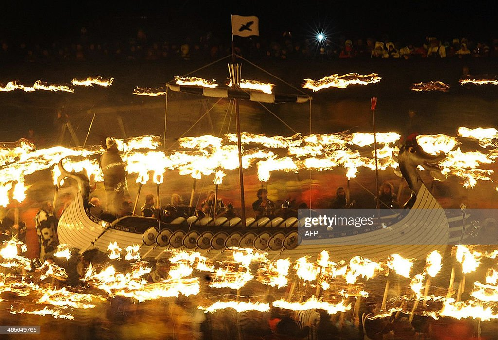 Participants dressed as Vikings process around their longboat during the annual Up Helly Aa festival in Lerwick Shetland Islands on January 28 2014...