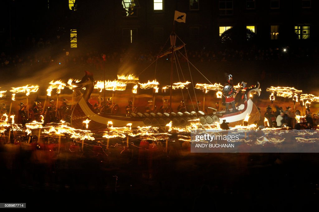 TOPSHOT Participants dressed as Vikings process around their longboat during the annual Up Helly Aa festival in Lerwick Shetland Islands on January...