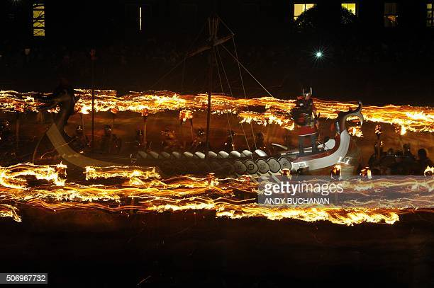 Participants dressed as Vikings process around their longboat during the annual Up Helly Aa festival in Lerwick Shetland Islands on January 26 2016...