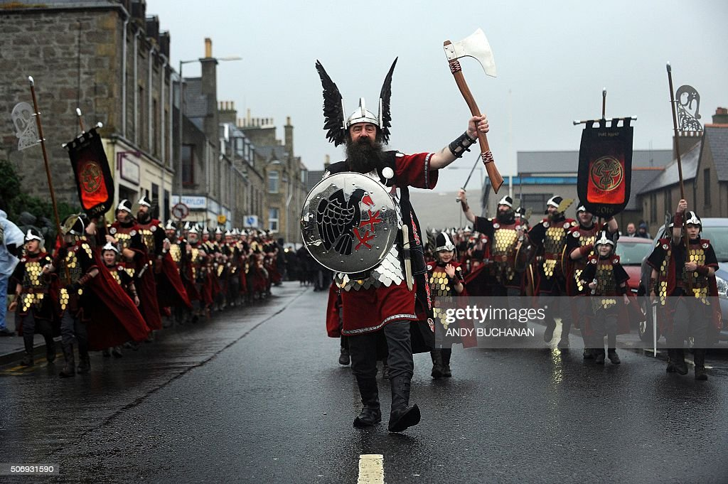 Participants dressed as Vikings process in the street as they prepare to participate in the annual Up Helly Aa festival in Lerwick Shetland Islands...