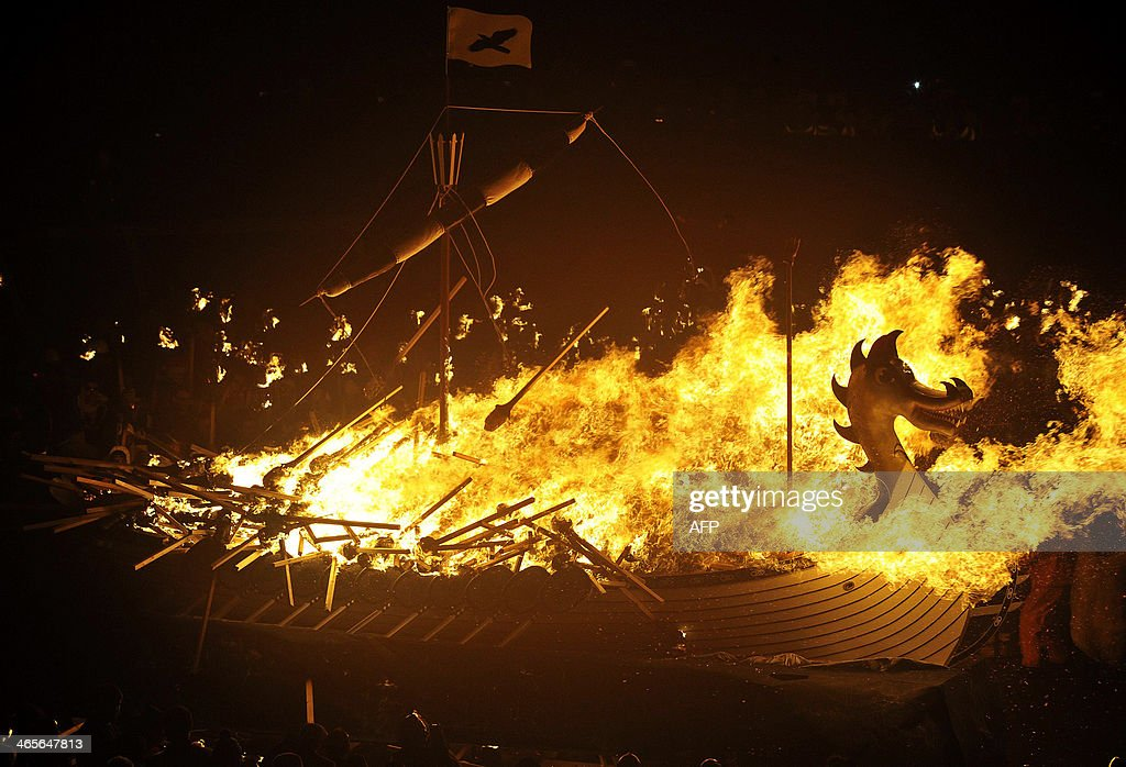 Participants dressed as Vikings set alight their longboat as they take part in the annual Up Helly Aa festival in Lerwick Shetland Islands on January...