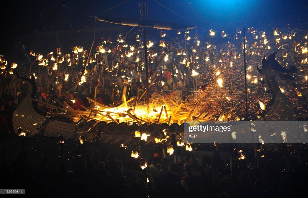 Participants dressed as Vikings set alight their longboat during the annual Up Helly Aa festival in Lerwick Shetland Islands on January 28 2014 Up...