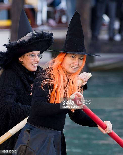 Participants dressed in costume row on the Grand Canal ahead of the 'Befana' Regatta on January 6 2014 in Venice Italy In Italian folklore Befana is...