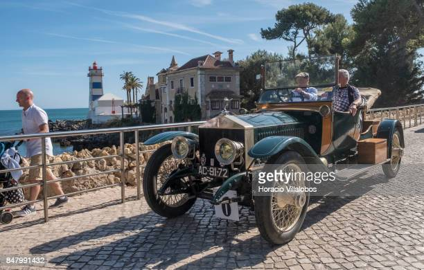 Participants drive a classic RollsRoyce on Rei Humberto II de Italia Avenue in front of Santa Marta Lighthouse during Cascais Classic Motor Show on...