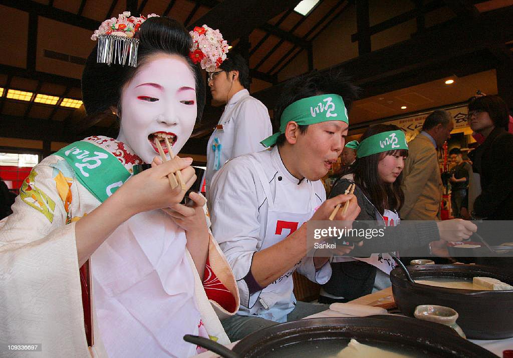Participants eat boiled bean curd during the 37th Boiled Bean Curd Eating Contest at Kiyomizu Junsei Okabeya on February 21, 2011 in Kyoto, Japan. The winner ate more than 3,500g bean curd in 30 minutes.