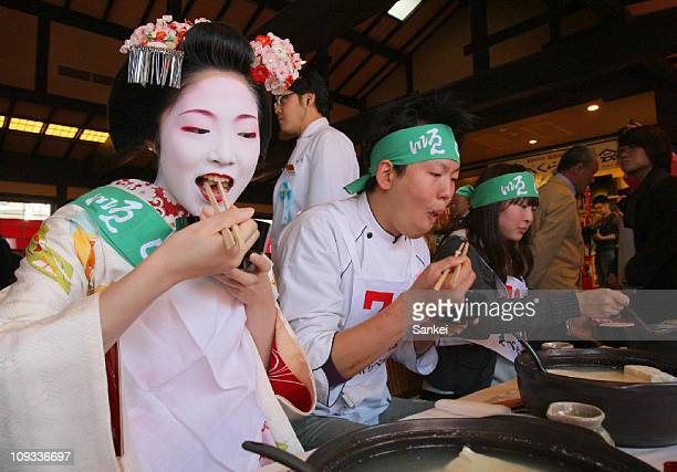Participants eat boiled bean curd during the 37th Boiled Bean Curd Eating Contest at Kiyomizu Junsei Okabeya on February 21 2011 in Kyoto Japan The...