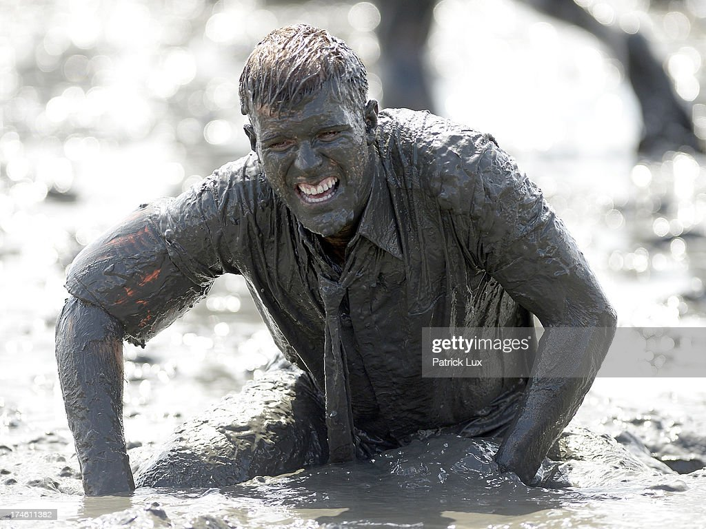 Participants enjoy playing in the mud during the mud flats olympics (Wattoluempiade) on July 28, 2013 in Brunsbuettel, Germany. The annual event takes place in the muddy tidal flats common to the north German coast and includes football, handball, volleyball and mud sledding.