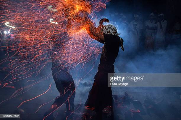 Participants fight during fire war ceremony at Dalem Temple on October 19 2013 in Tuban Kuta Indonesia The annual ceremony known locally as Siat Geni...