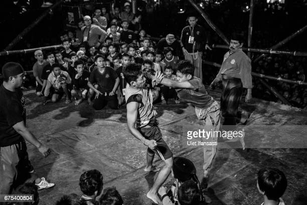 Participants fight during Pencak Dor competition at the yard of Lirboyo islamic boarding school on April 29 2017 in Kediri East Java Indonesia In...