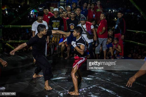 Participants fight during the Pencak Dor competition at the yard of Lirboyo islamic boarding school on April 29 2017 in Kediri East Java Indonesia In...