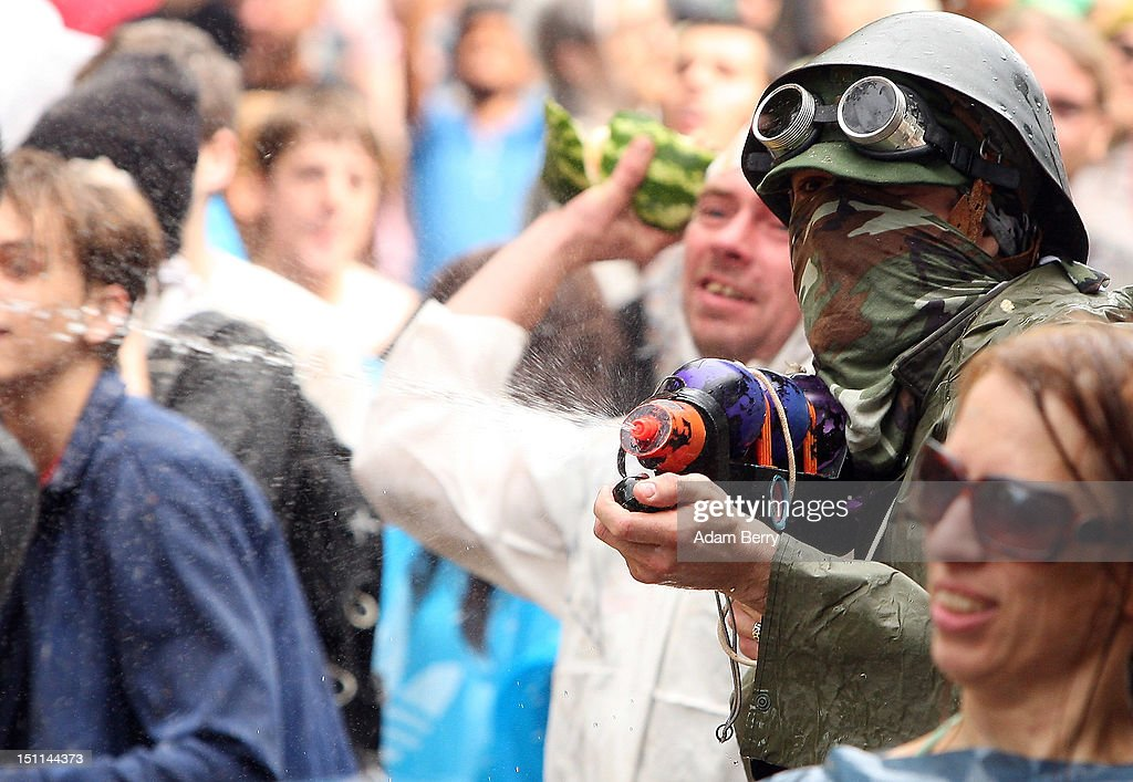 Participants fight in the the annual Vegetable Battle (Gemueseschlacht) on the Oberbaumbruecke on September 2, 2012 in Berlin, Germany. The event pits Kreuzberg district residents againts those of Friedrichshain for control of the Oberbaumbruecke (Oberbaum Bridge), and the two sides pelt each other with rotten vegetables, pet food, ketchup, chicken drumsticks, flour, water guns and styrofoam bats until one side has pushed the other from the bridge. Friedrichshain won the war, in revenge for Kreuzberg's victory the previous year.