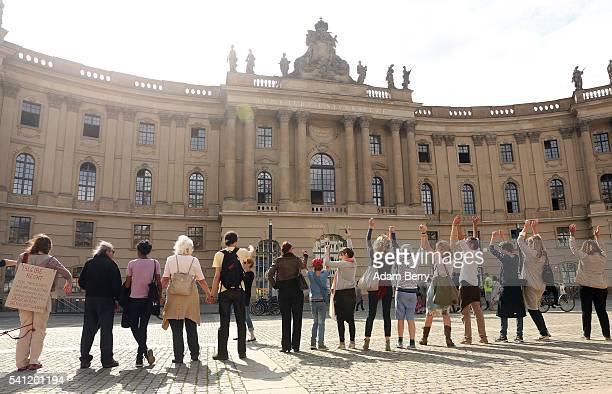 Participants form a human chain in a demonstration calling for tolerance of minorities and discouraging racism on June 19 2016 at Bebelplatz site of...