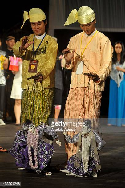 Participants from Cambodia perform at Traditional Performing Arts of Puppet Performance 2014 organized with the collaboration of ASEANChina in...