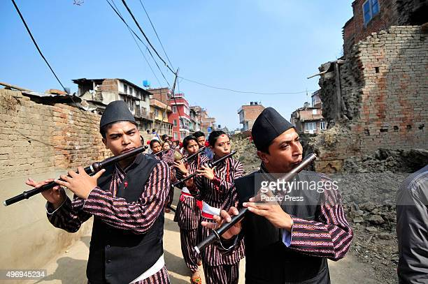 KIRTIPUR KATHMANDU NEPAL KATHMANDU NP NEPAL Participants from Newari community plays traditional flutes during parade of Nhu Dan which falls on Tihar...