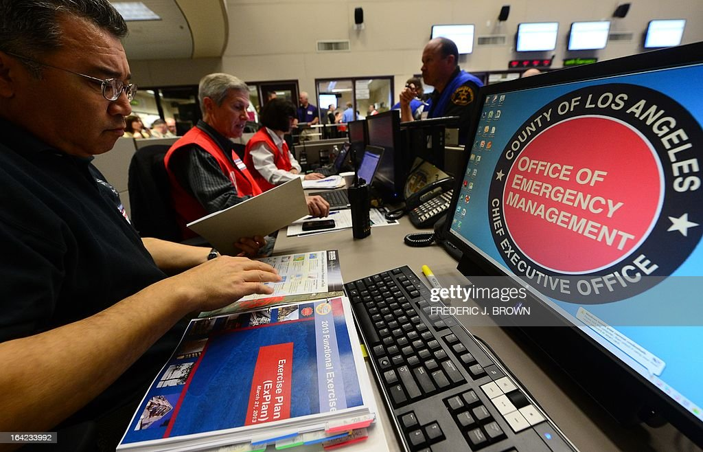 Participants from the I.T (L) and Disaster Management (C/R) work side by side at the Command Center of the Office of Emergency Management in Los Angeles, California, during a functional exercise for first responders in a simulated 7.8 magnitude earthquake drill on March 21, 2013. This year's exercise featured the California Integrated Seismic Network's Earthquake Early Warning Demonstration System and participation from 53 City emergency operations centers, including some departments and organizations such as Fire, Water, Coroner, Sheriff and Public Works as well as the American Red Cross and Emergency Network Los Angeles. The functional exercise is a training event designed to test and evaluate selected emergency functions and the interaction of various levels of government, response organizations, volunteer groups, and industry in a simulated environment, usually involving key decision makers, the local emergency operations center and representatives from response and support organizations. AFP PHOTO/Frederic J. BROWN