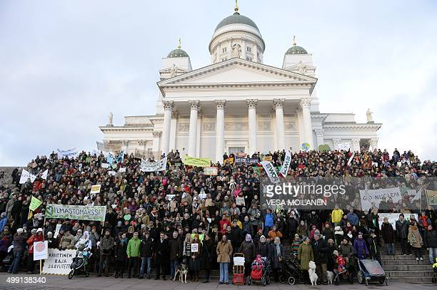Participants gather in front of the Helsinki Cathedral during a Climate March organised by environmental NGOs on November 29 2015 in Helsinki Finland...