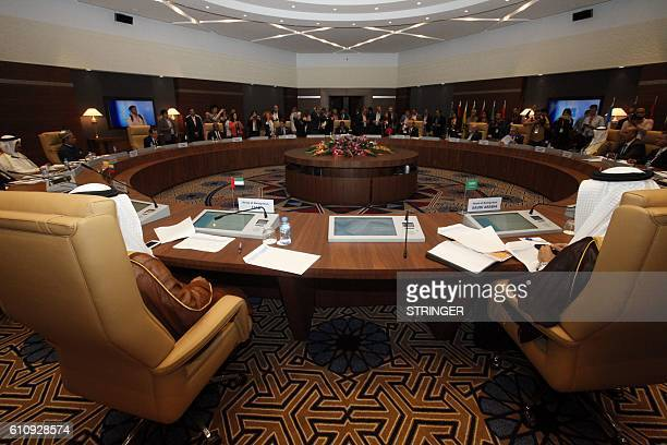 Participants gather in the lobby ahead of an informal meeting between members of the Organization of Petroleum Exporting Countries OPEC in the...