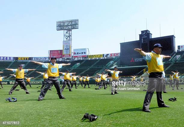 Participants gesute during a training session ahead of the All Japan High School Baseball Championship prefectural qualifiers at Hanshin Koshien...