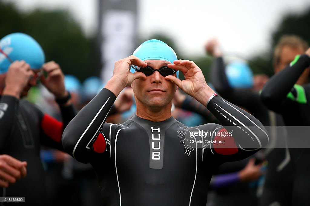 Participants get ready to compete in the swim leg during the Ironman 70.3 UK at Exmoor National Park on June 26, 2016 in Somerset, England.
