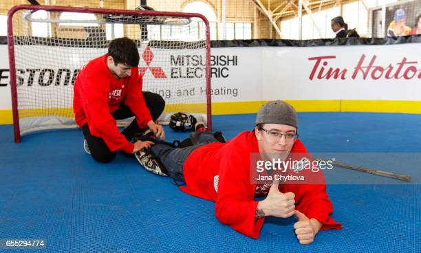 Participants get ready to play ball hockey by putting on goalie gear at the NHL Centennial Fan Arena at the Aberdeen Pavilion on March 19 2017 in...