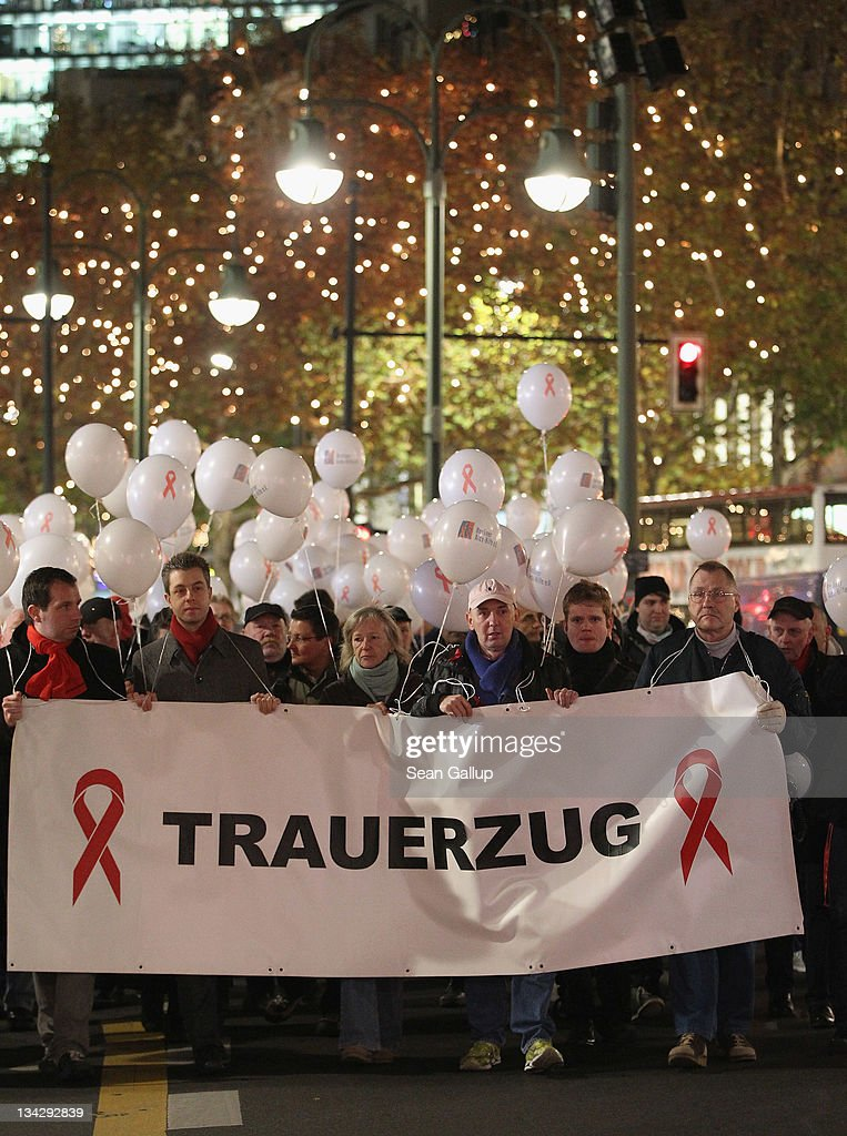 'March of Mourning' in a march to commemorate the victims of AIDS on November 30, 2011 in Berlin, Germany. Several hundred people, mostly members of the city's gay community, participated in the march one day ahead of World AIDS Day.