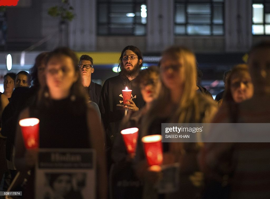 Participants hold a candle light vigil for two refugees, a Somali woman and an Iranian man who set themselves on fire on the remote Pacific island of Nauru, in Sydney on May 4, 2016. More than 750 asylum-seekers held in a Papua New Guinea detention camp launched legal action on May 4, 2016 to be moved to Australia after a court in the Pacific nation found the centre unconstitutional. / AFP / SAEED
