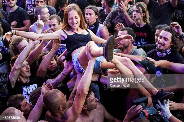 Participants hold a fan over their heads during a concert at the 2015 Woodstock Festival Poland on August 1 2015 in Kostrzyn Poland The Polish...