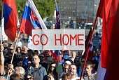 Participants hold flags and a banner during an antiimmigration rally organised by an initiative called 'Stop Islamisation of Europe' and backed by...