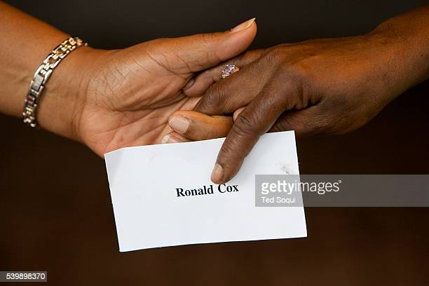 Participants hold hands while holding cards with the names of Katrina victims during the 'Hands Around The Dome Ceremony' in New Orleans One year...