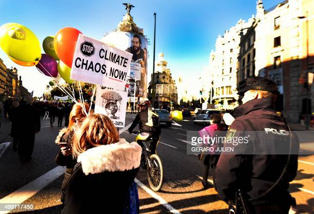 Participants hold placards as they march during the 'Global Climate March' on November 29 2015 in Madrid called by environmental NGOs on the eve of...