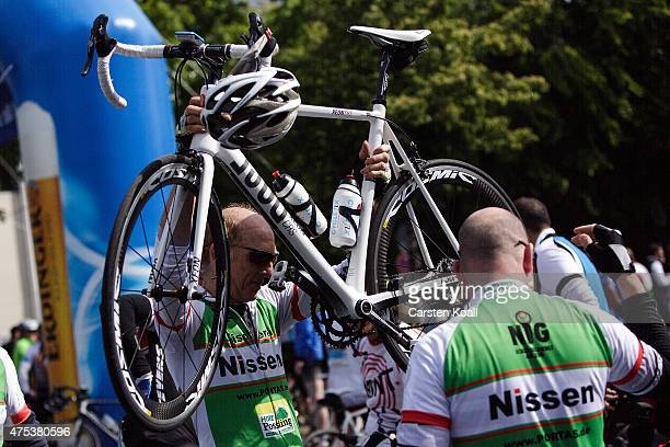 Participants holds a bycicle after ride a bike part at the 8th Garmin Velothon on May 31 2015 in Berlin Germany Ten thousand bike enthusiasts drove...